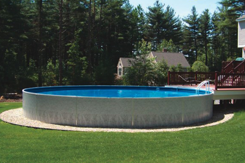 Waide's Pools & Spas Freestanding Radiant above ground swimming pool with deck and ladder in East Erie, PA.